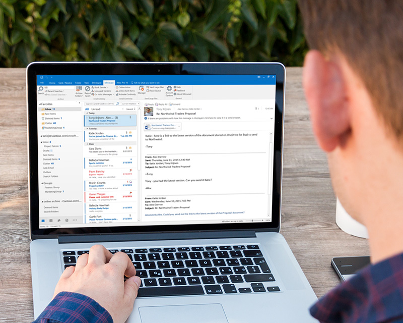 Microsoft Outlook with Mimecast email security plugin displayed on a laptop